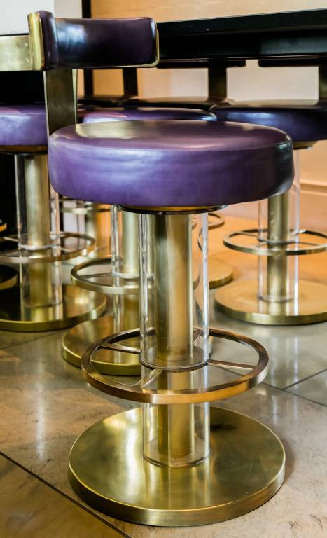 Bar stool in brass and acrylic upholstered in purple leather, 2015