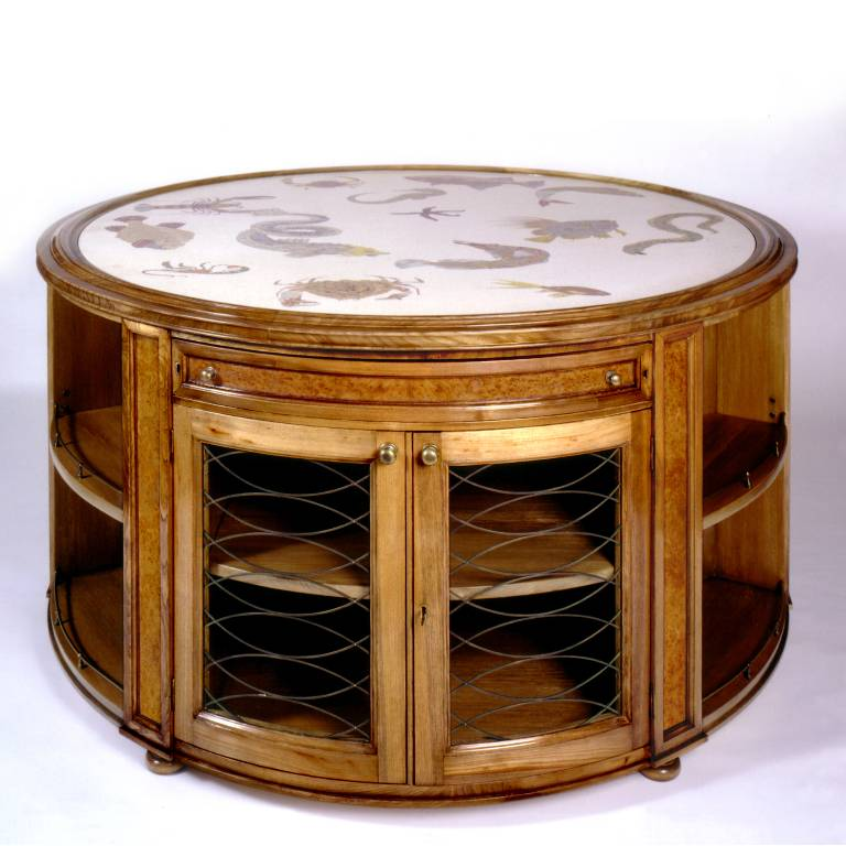 Circular library table in elm and burr elm with a scagliola top, 2004