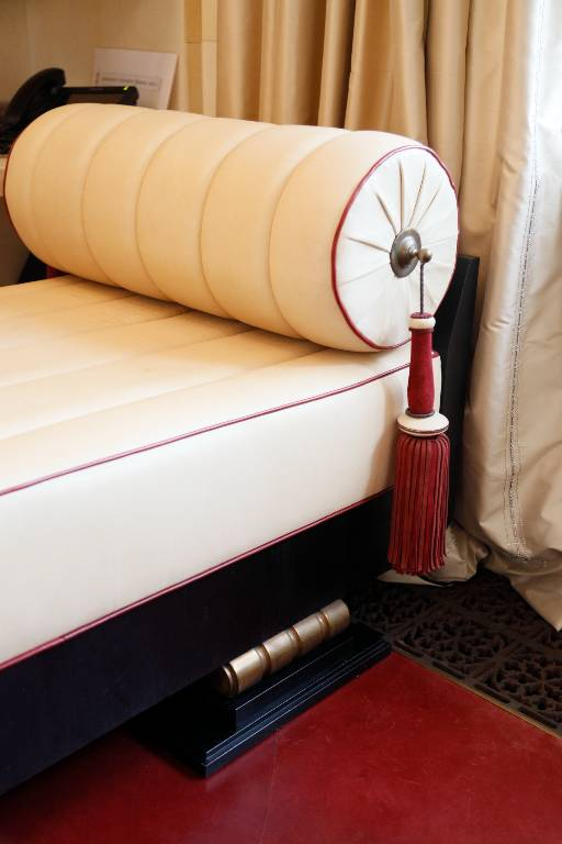 Day bed in cream and burgundy leather on an ebonised timber base with bronze feet, 2014