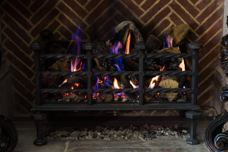 Gas lit fire basket in wrought and cast iron, 2015