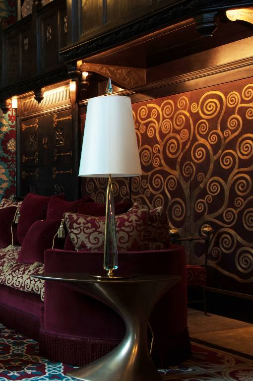 Motorised cabinet doors in antiqued leather inlaid with etched brass, 2014