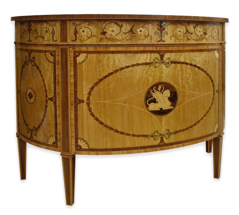 One of a pair of demi lune commodes in inlaid satinwood 2004