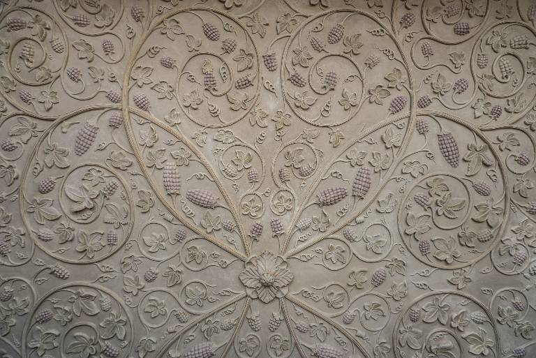 Plasterwork ceiling antiqued white distemper picked out in gilding and washes of colour, 2010