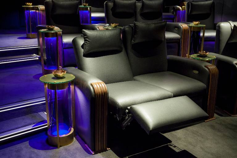 Reclining cinema sofas in walnut and black leather with illuminated side tables in brass and blue glass, 2014