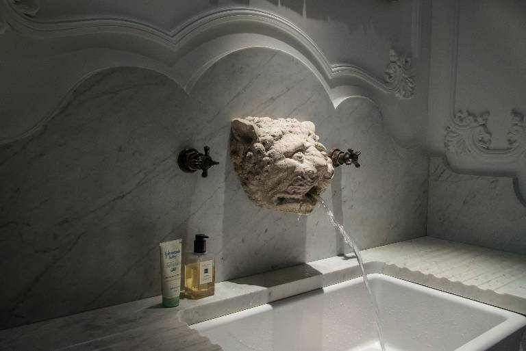 Washstand in bardiglio carara marble and limestone with bronze taps and surrounding decoration in fibrous plaster, 2014