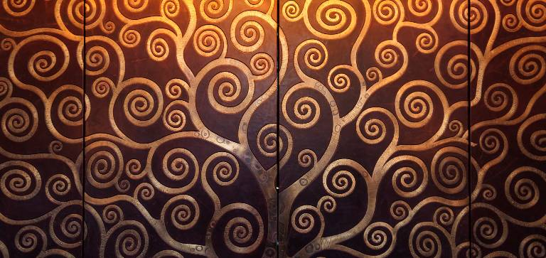 Leather and bronze cabinet doors designed by Misti Leitz