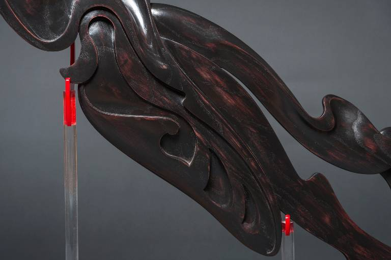 mid section of the hand carved wood sculpture