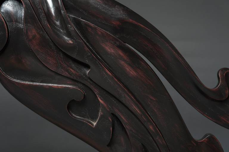 close up showing the beautifully polished ebonised finish on the ash carved sculpture