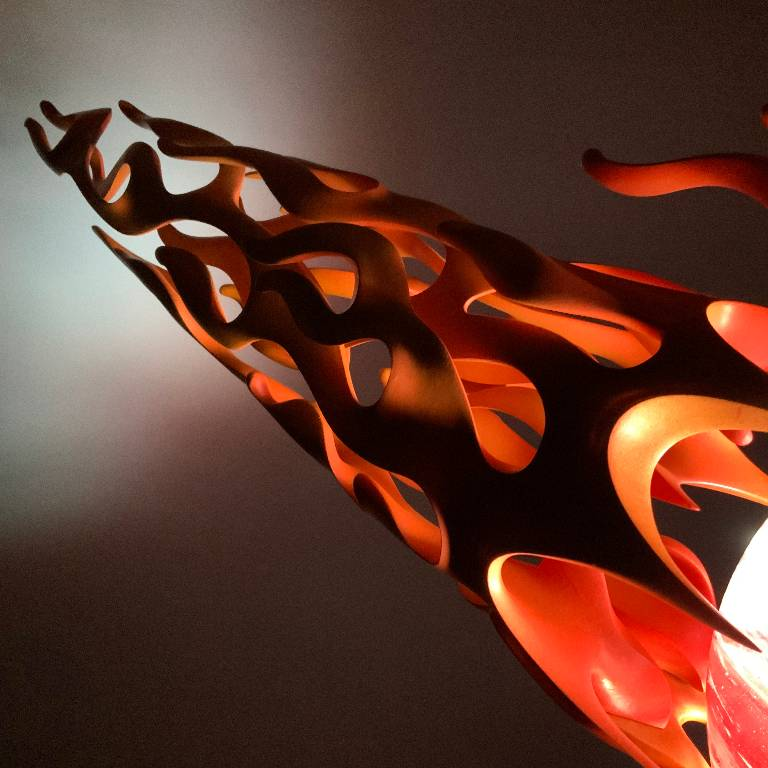 close up of the flame details illuminated from inside the sculpture