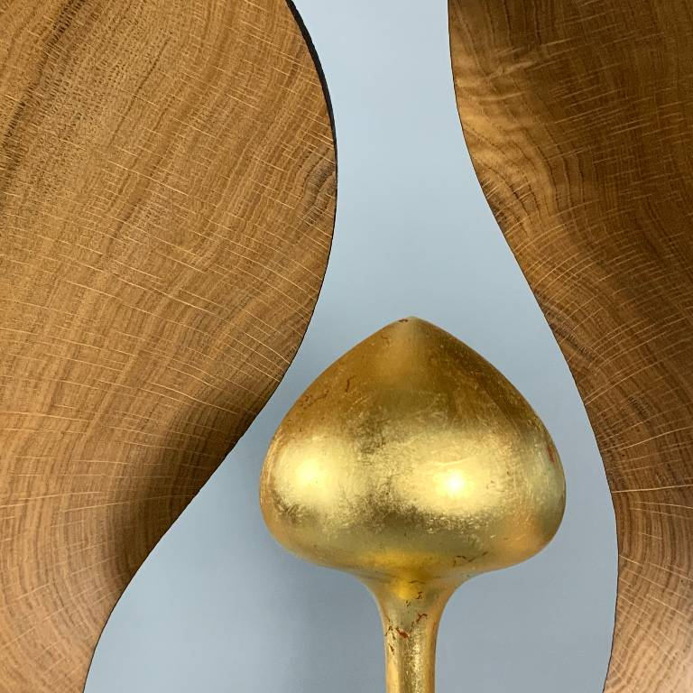 The oiled oak grain radiates from the centre of the sculpture