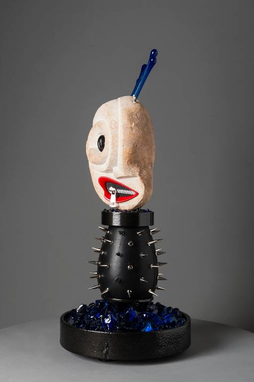 A fetish doll inspired mixed media sculpture
