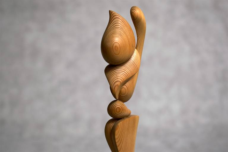 Sculpture detail showing the beautiful grain in the movement of the piece